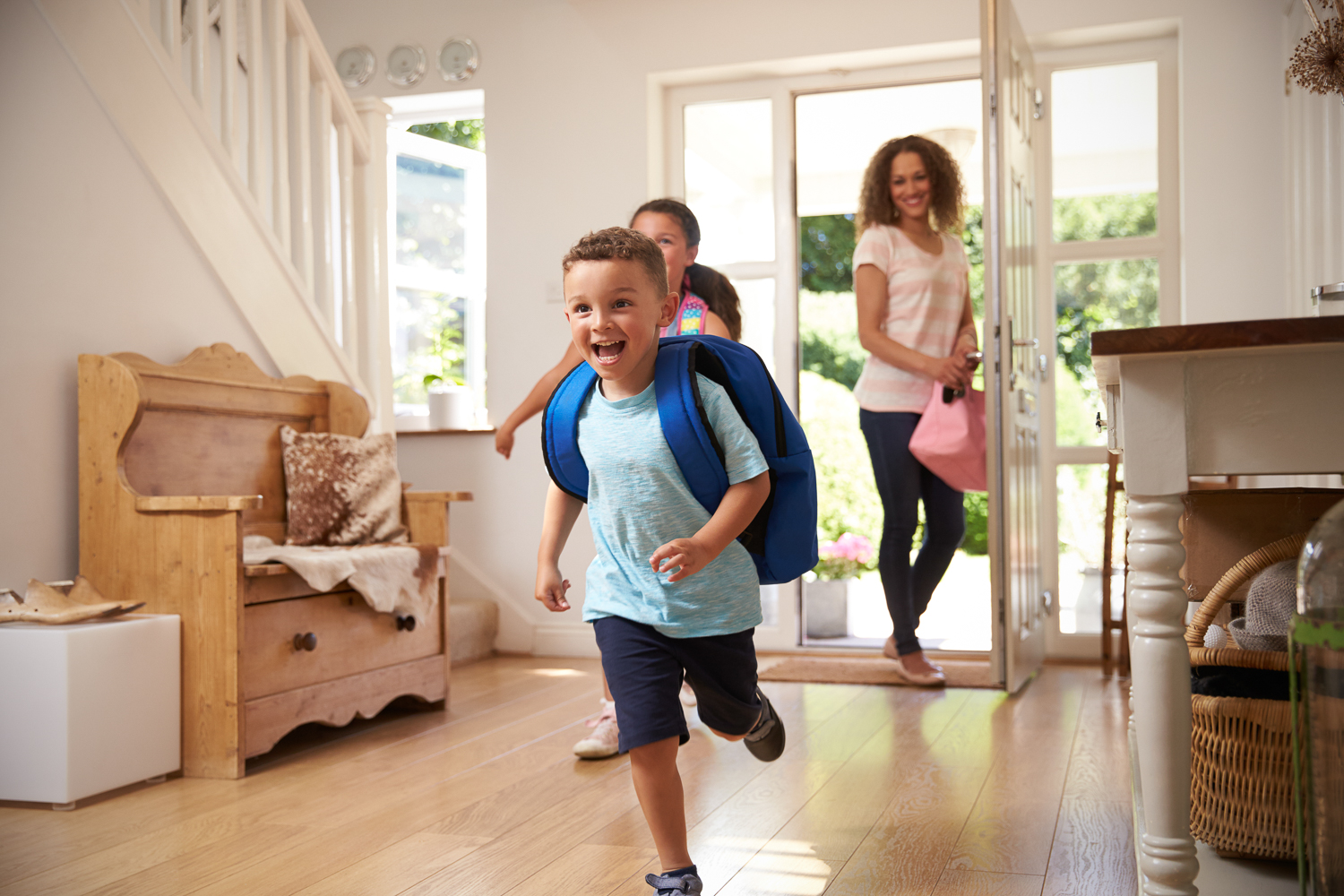 Kids excited to be home from school with their mom